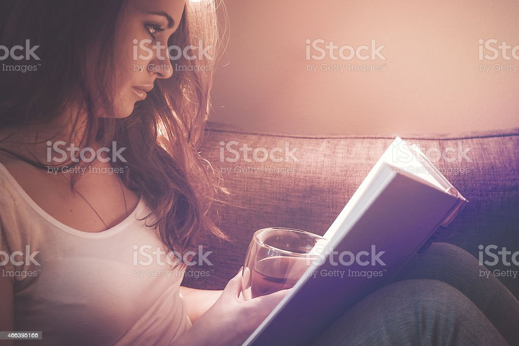 Fascinating reading a book stock photo