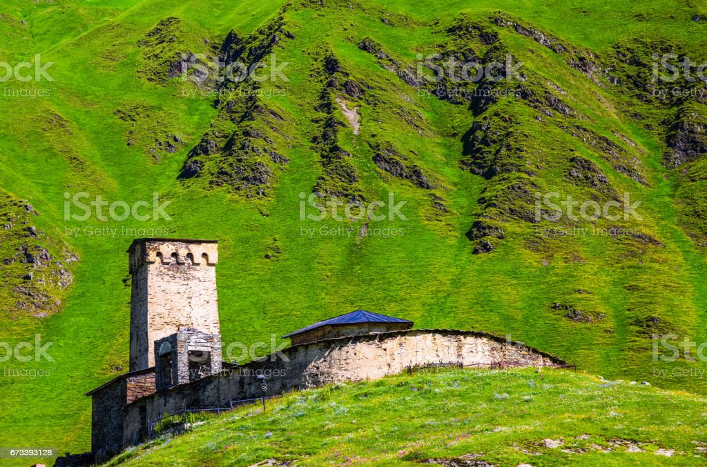 A fascinating view on Ushguli village at the foot of snow-capped Mt. Shkhara. Location place Lamaria Church Jgrag, Upper Svaneti, Georgia, Europe. stock photo