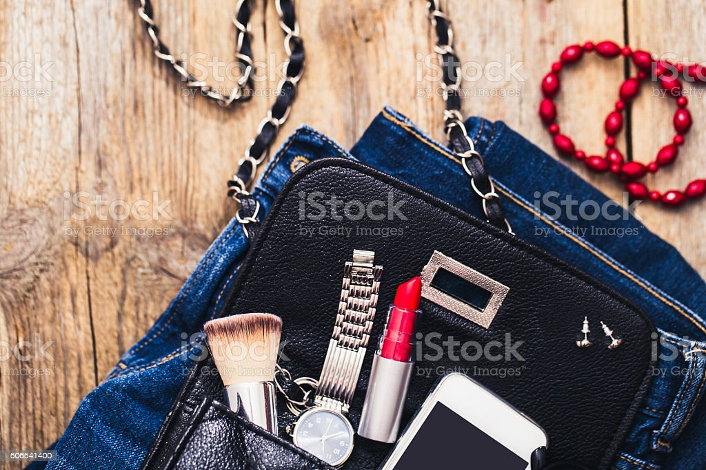 Fashion accessories for a young girl, watch, bracelet, handbag stock photo