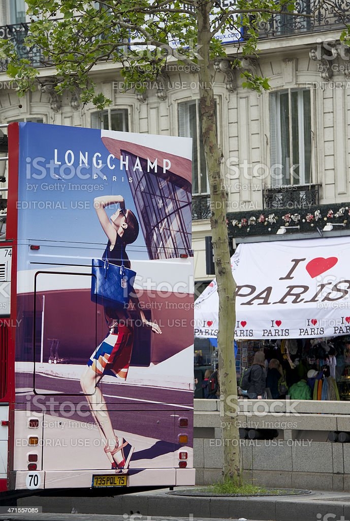 Fashion advertisement on bus in Avenue des Champs-Élysées, Paris royalty-free stock photo