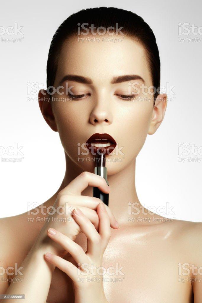 Fashion and beauty. Beautiful young woman with wine lipstick stock photo