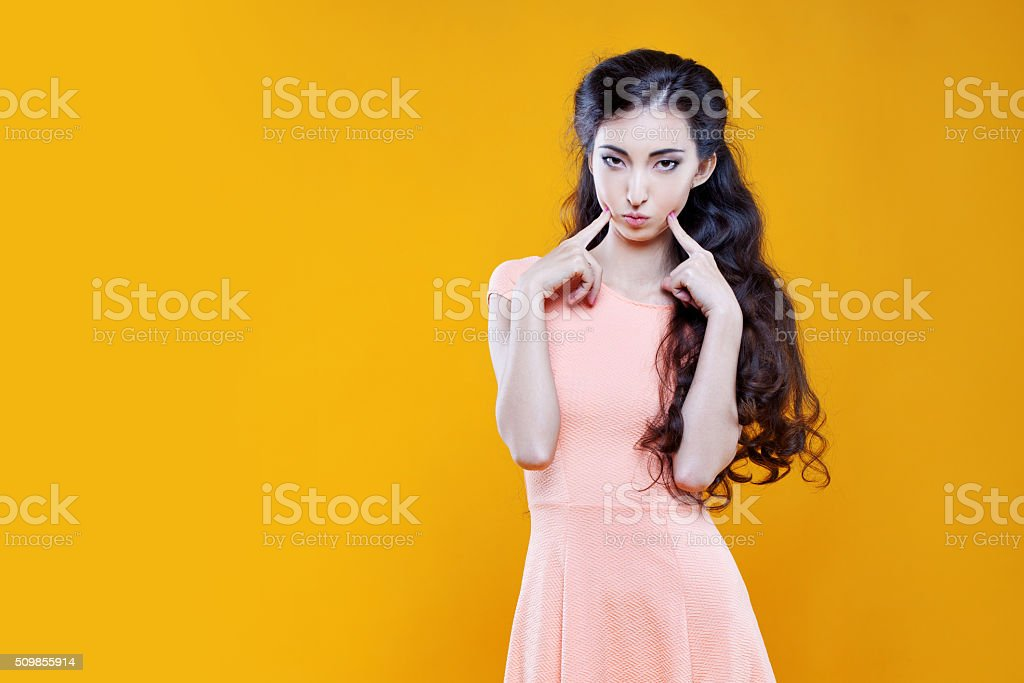Fashion asian young  girl. Portrait on yellow background stock photo