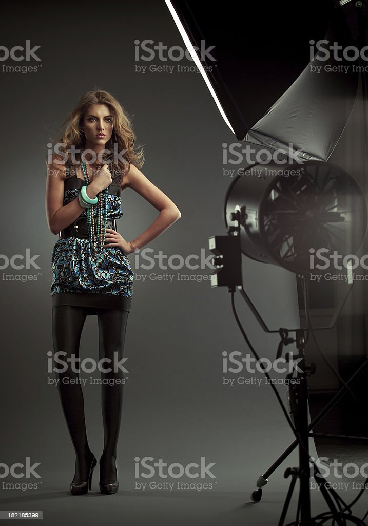 Fashion backstage style portrait of young woman on dark background stock photo