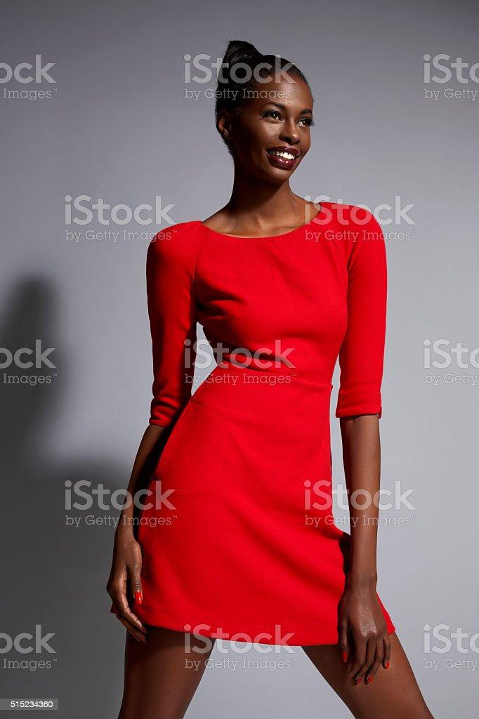 Fashion  Beautiful african ethnicity  young women   Wearing a red dress stock photo