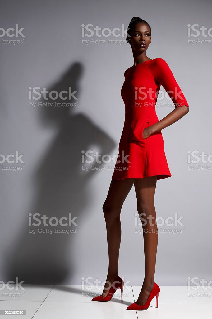 Fashion  Beautiful african ethnicity  young women   Wearing a red dress stock photo