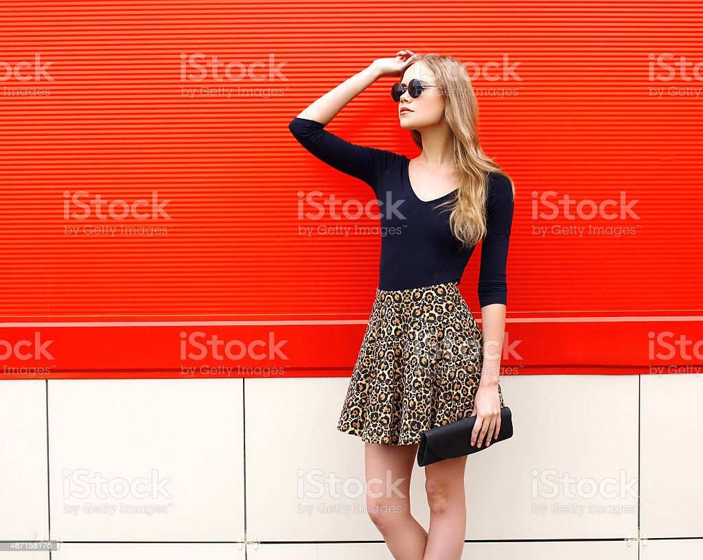 Fashion beautiful woman model in leopard skirt and sunglasses wi stock photo