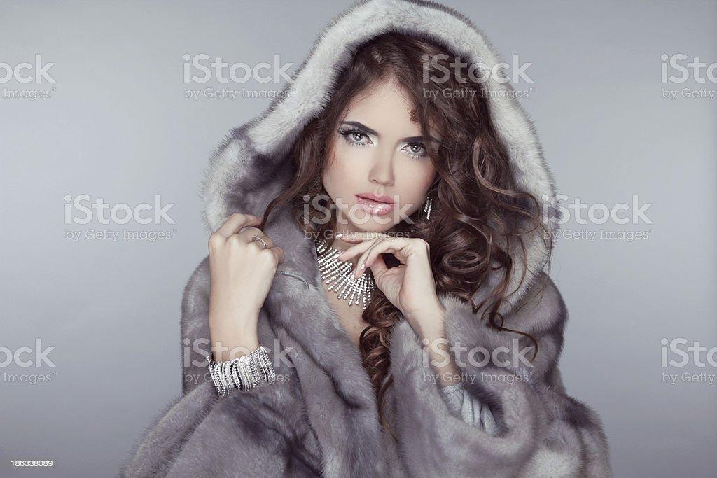 Fashion beautiful woman posing in fur coat. Winter Girl  Model stock photo