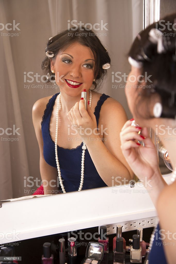 Fashion:  Beautiful young woman's reflection in a hollywood make-up mirror. royalty-free stock photo