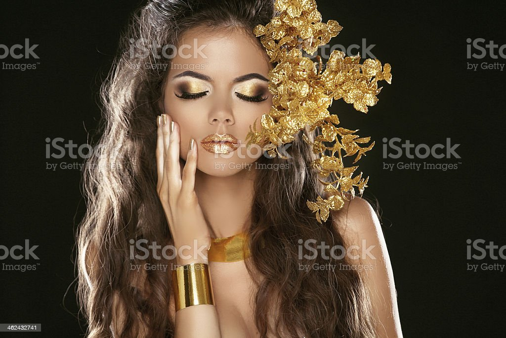 Fashion Beauty Girl Isolated on Black Background. Makeup. Golden royalty-free stock photo