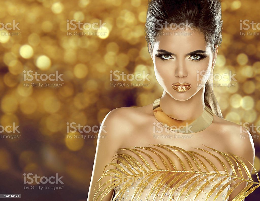 Fashion Beauty Girl Isolated on golden bokeh Background. Makeup. stock photo