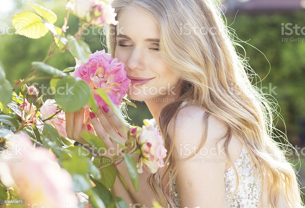Fashion beauty girl with roses flowers stock photo
