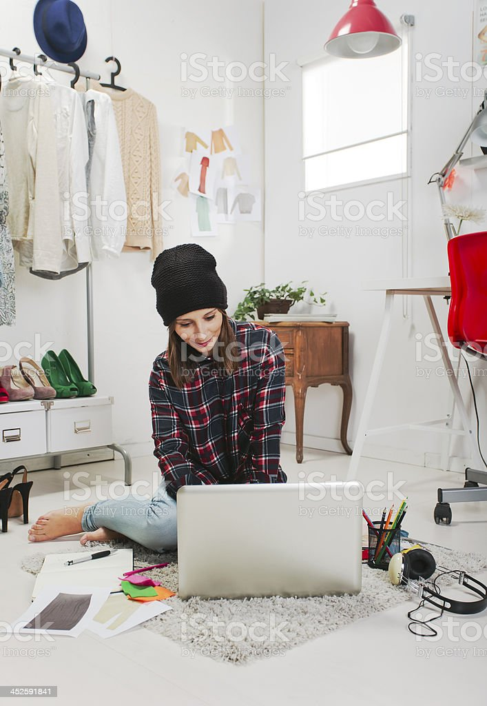 A fashion blogger working in her laptop stock photo