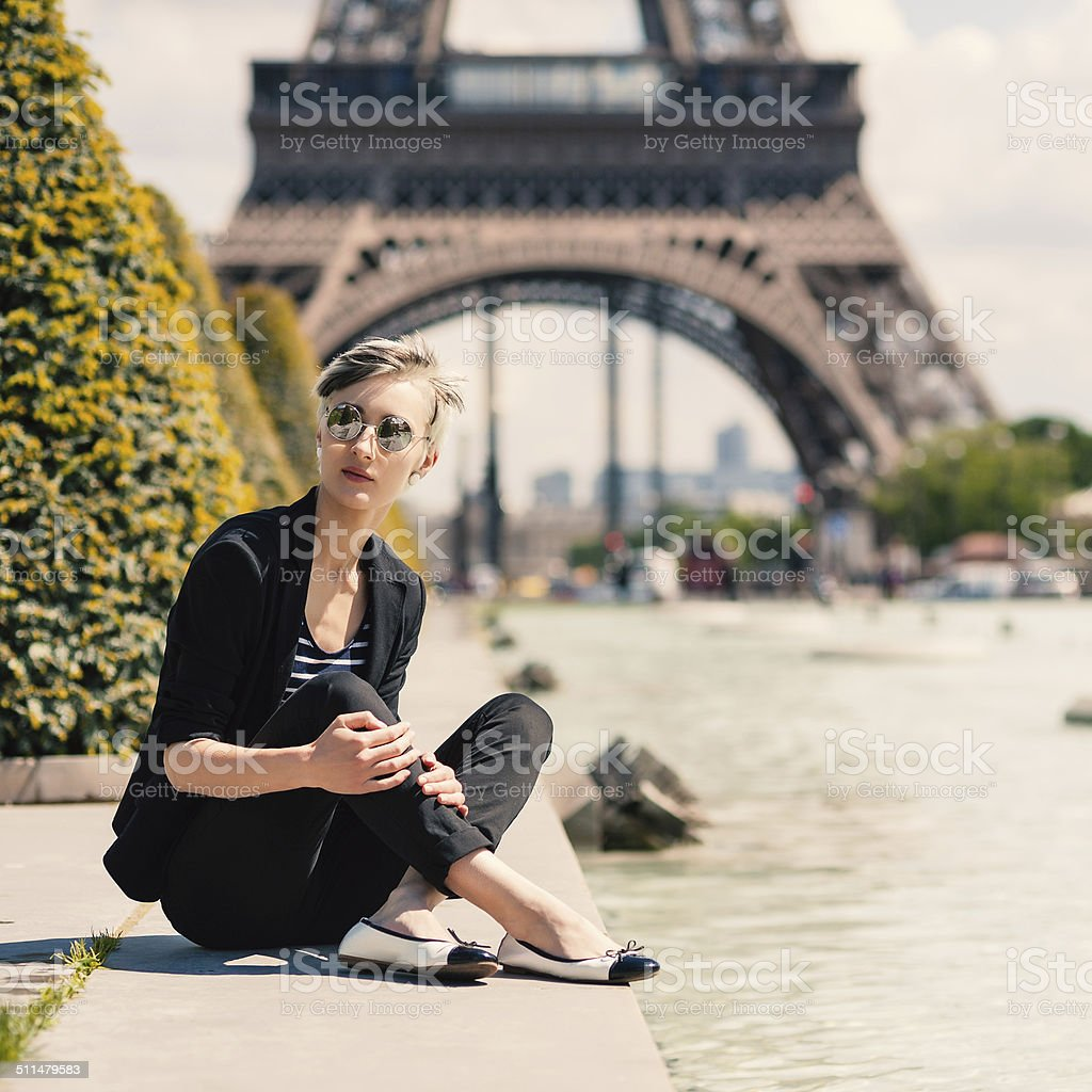 Fashion blonde woman portrait in front of the Eiffel Tower. stock photo