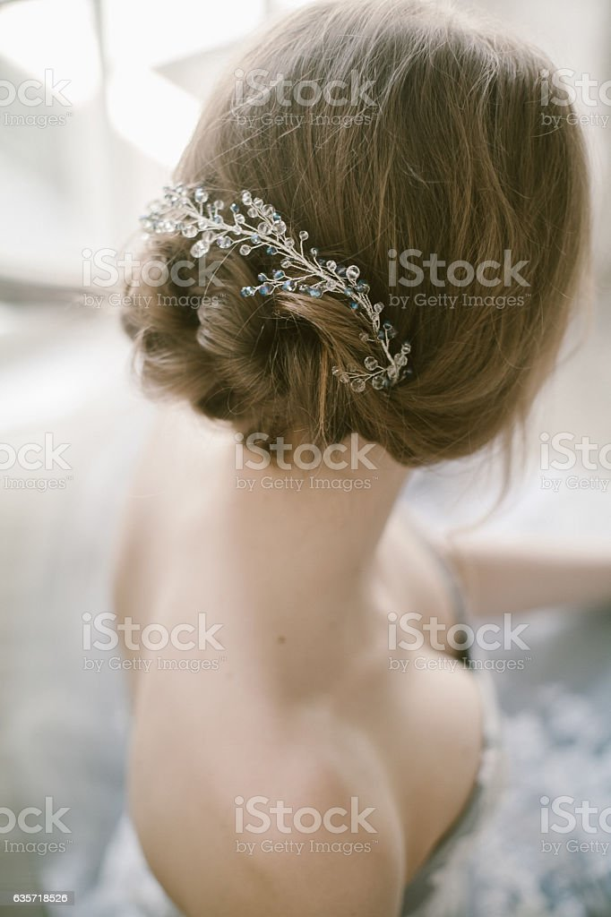 Fashion bridal hairstyle with jewellery decoration in hair. stock photo