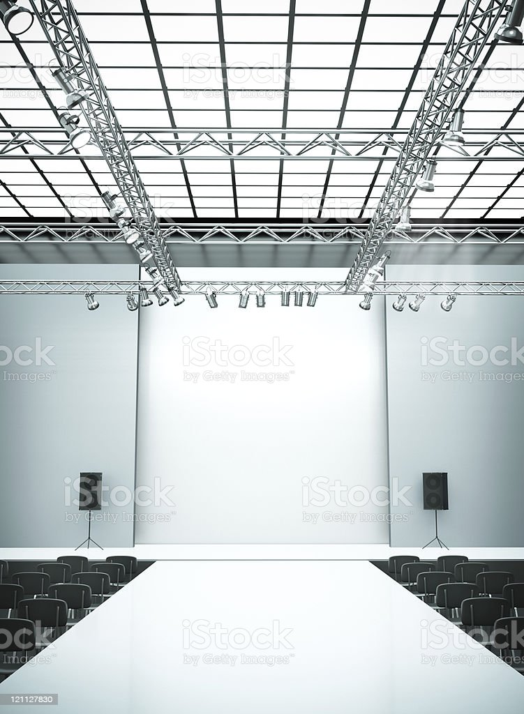 Fashion catwalk stage with lighting and seats stock photo