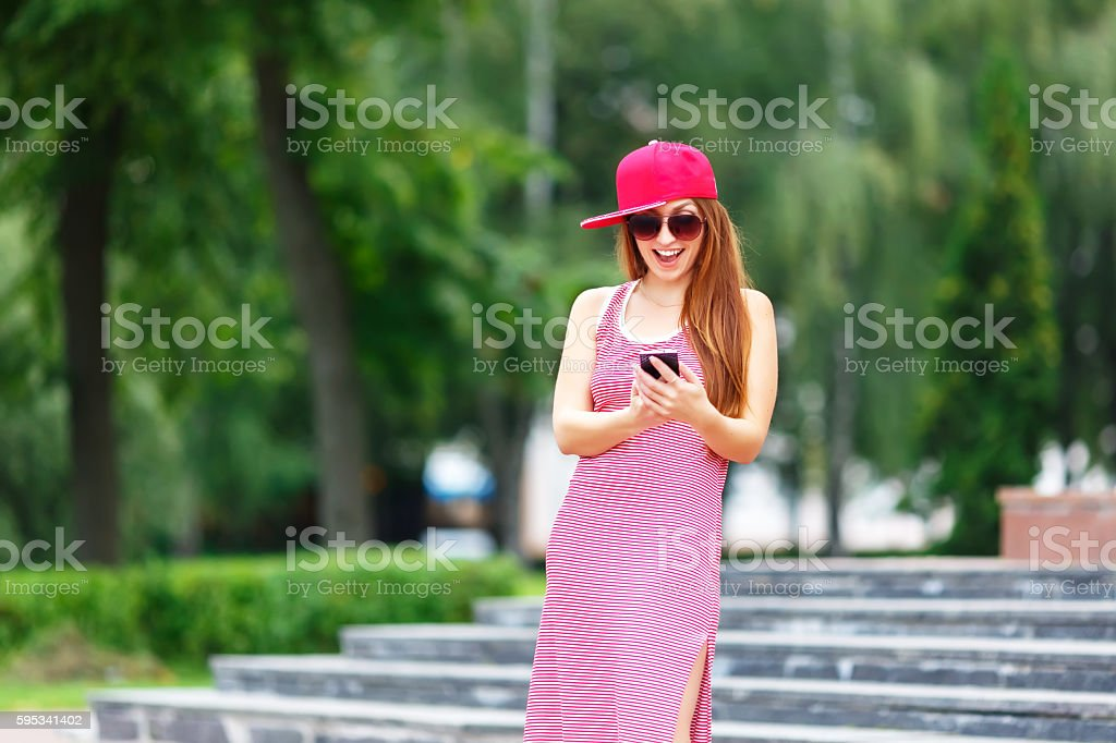Fashion city portrait of stylish hipster woman talking mobile phone stock photo