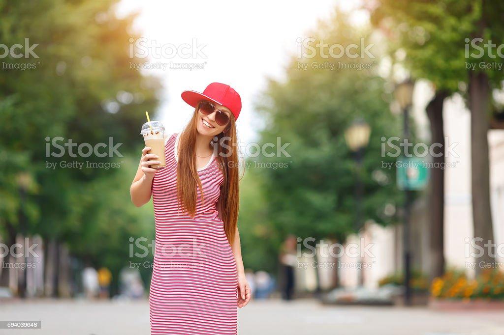 Fashion city portrait of stylish hipster woman with milk shake, stock photo