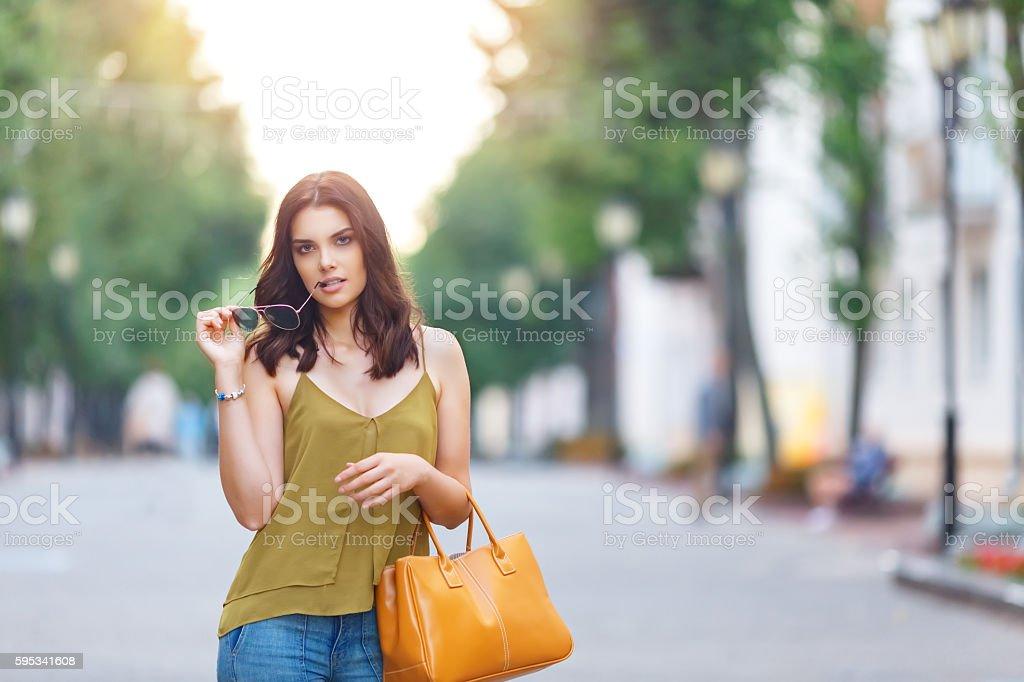 Fashion city portrait of stylish hipster womanwith bag, natural dress, stock photo