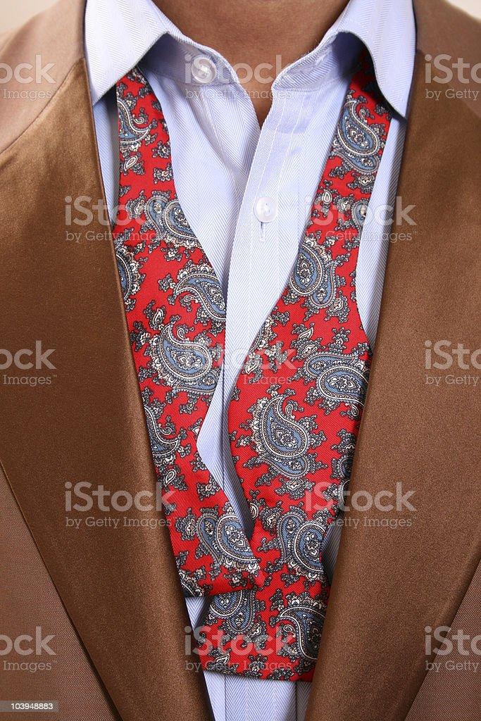 Fashion Closeup - Velour Blazer With Undone Paisley Bow-tie royalty-free stock photo