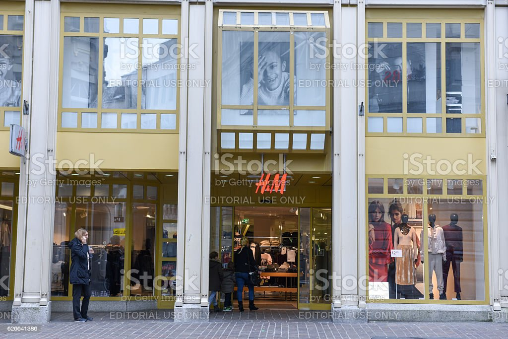 H&M fashion clothes store on the mall of St. Gallen stock photo