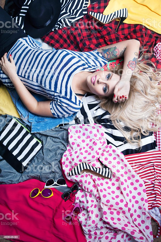 Fashion concept young attractive woman lying down stock photo