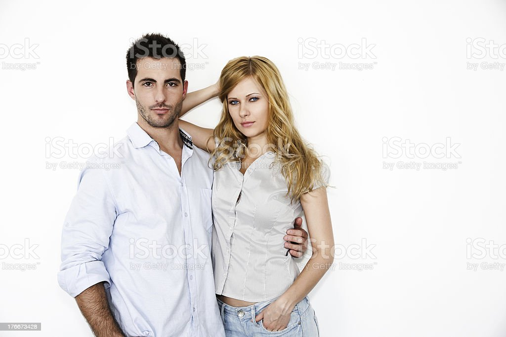 Fashion couple in front of white background royalty-free stock photo