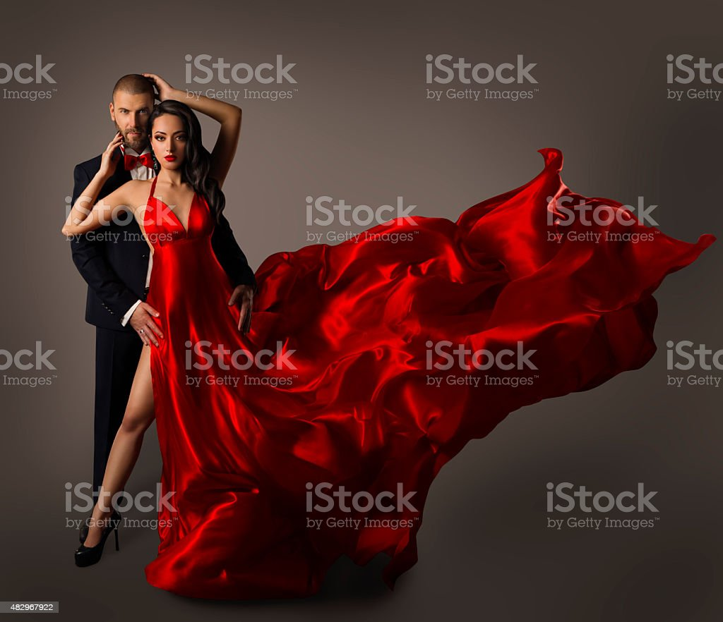 Fashion Couple Portrait, Woman Red Dress, Man Suit, Flying Cloth stock photo