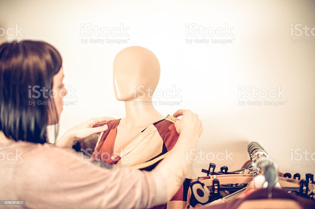 Fashion Designer Adjusting Cloth on Tailor's Dummy, Copy Space stock photo