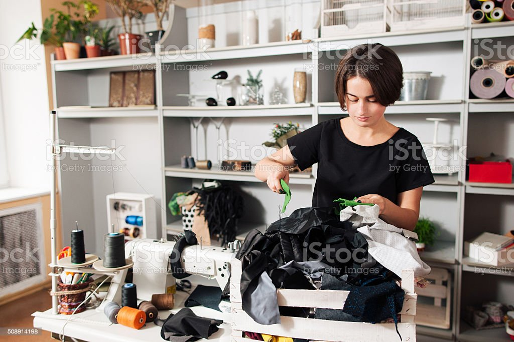 Fashion designer chooses fabric samples stock photo