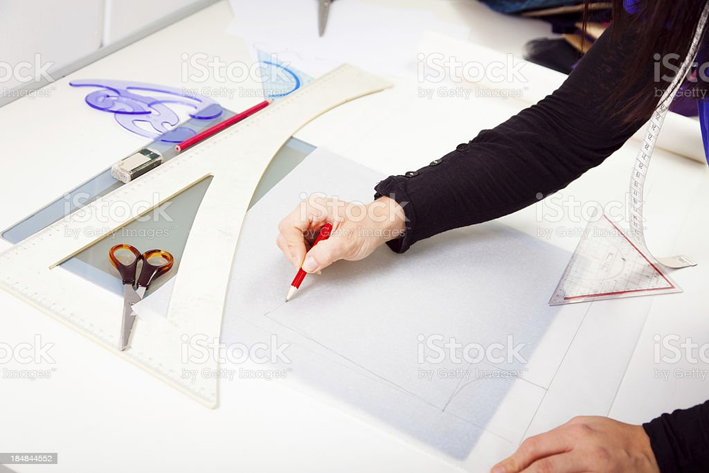 fashion designer in her studio stock photo
