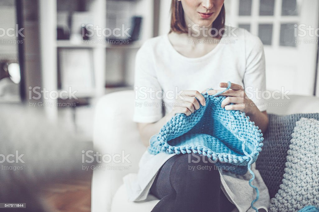 Fashion designer is knitting in her showroom stock photo