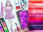 Fashion designer material sample and hand-drawn illustration