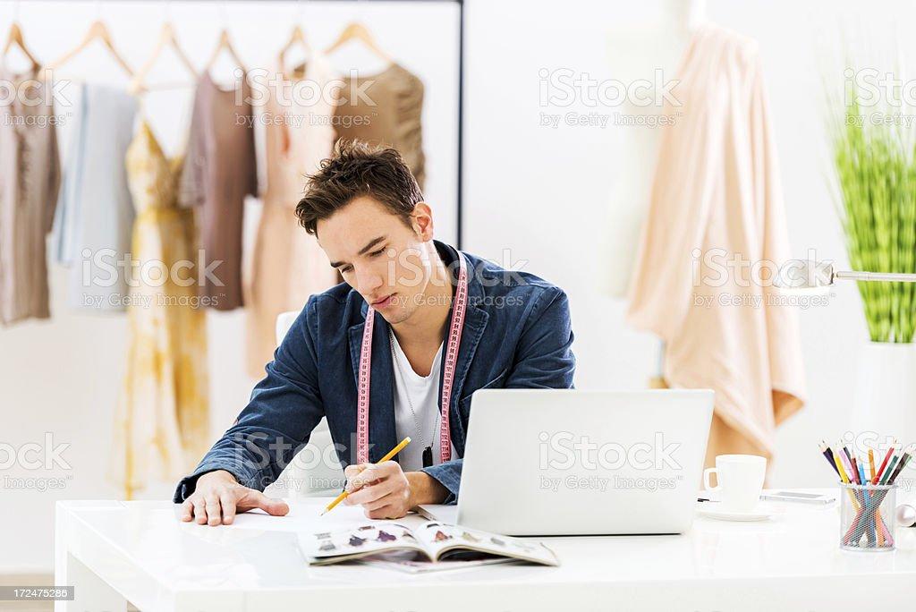 Fashion designer sketching at design studio. royalty-free stock photo