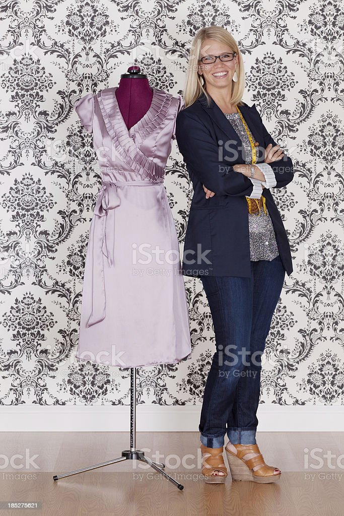 Fashion designer standing near mannequin royalty-free stock photo