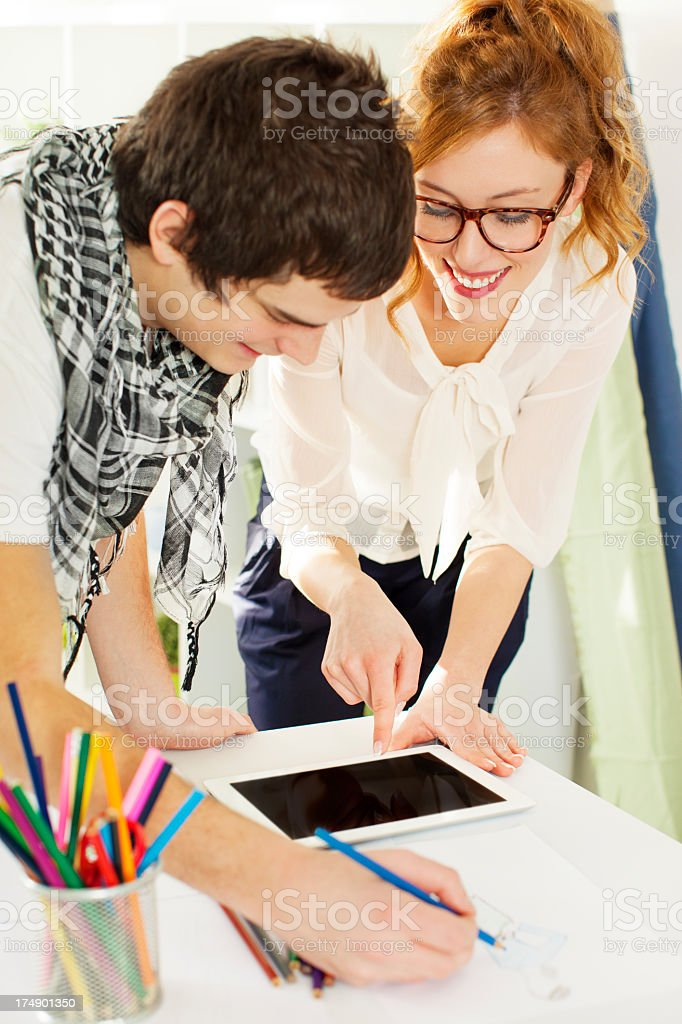 Fashion Designer Team Looking at Digital Tablet royalty-free stock photo