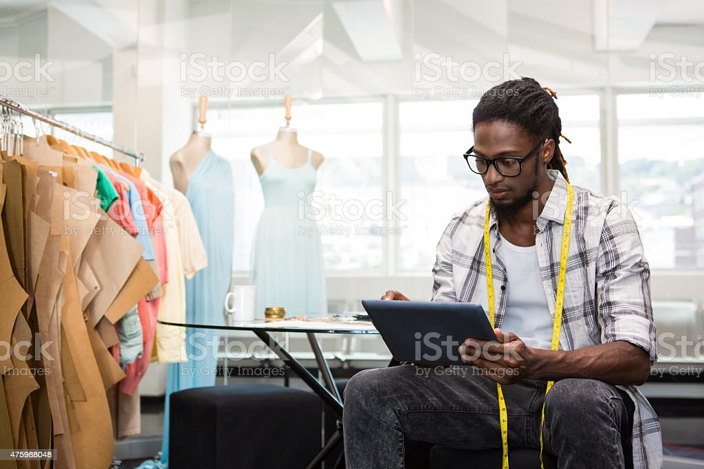 Fashion designer using digital tablet stock photo
