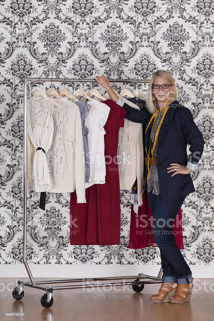 Fashion designer with her creations royalty-free stock photo
