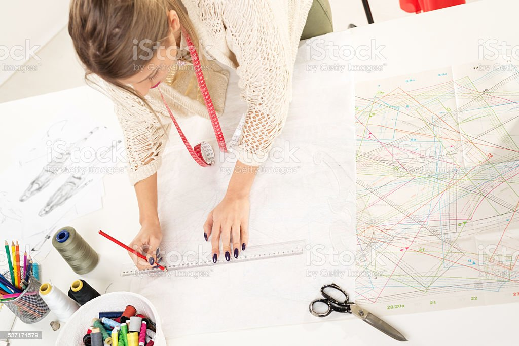 Fashion Designer With Sewing Pattern stock photo