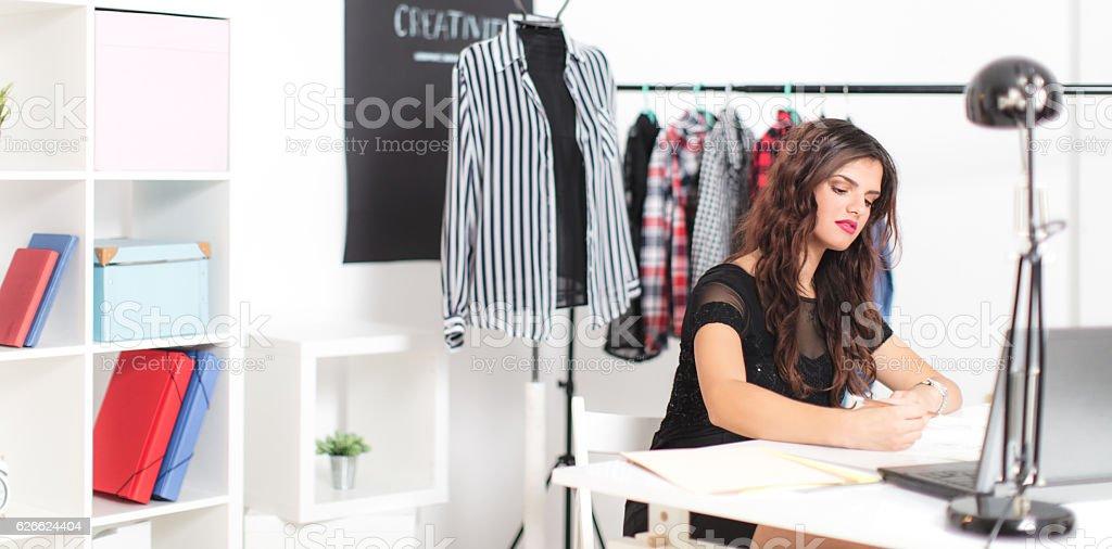 Fashion designer woman working at studio stock photo