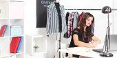 Fashion designer woman working at studio