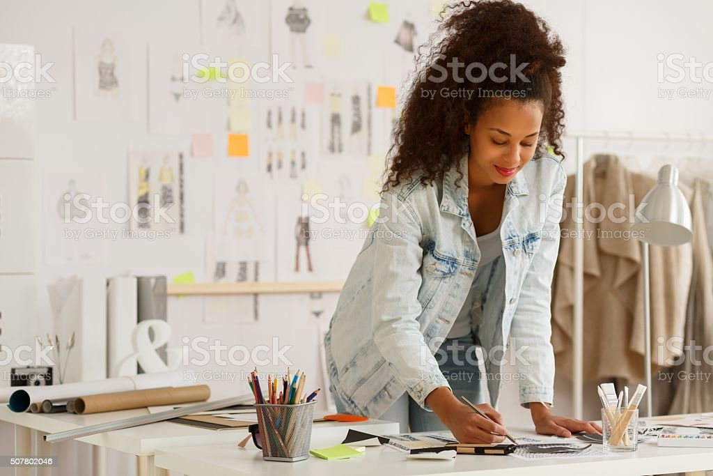Fashion designer working in atelier stock photo