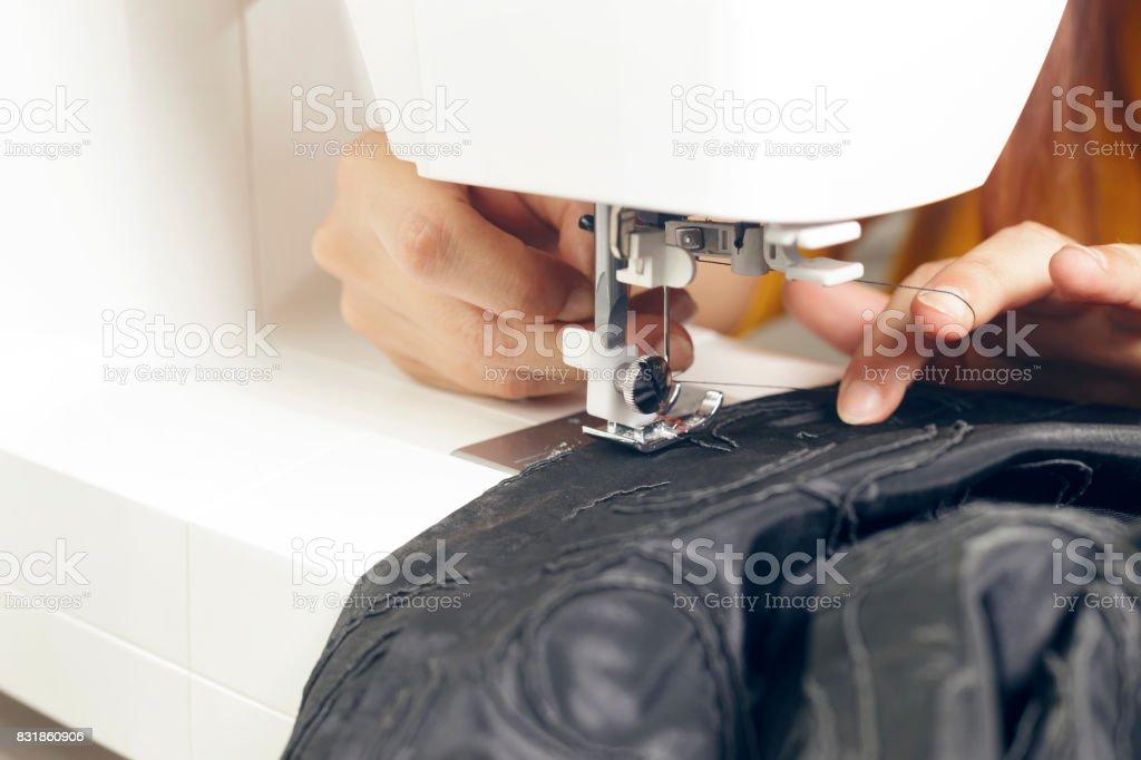 Fashion designer working on a design. stock photo