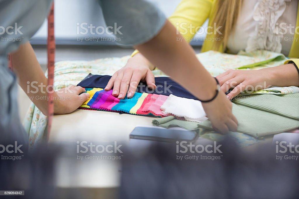 Fashion designer working on new design stock photo