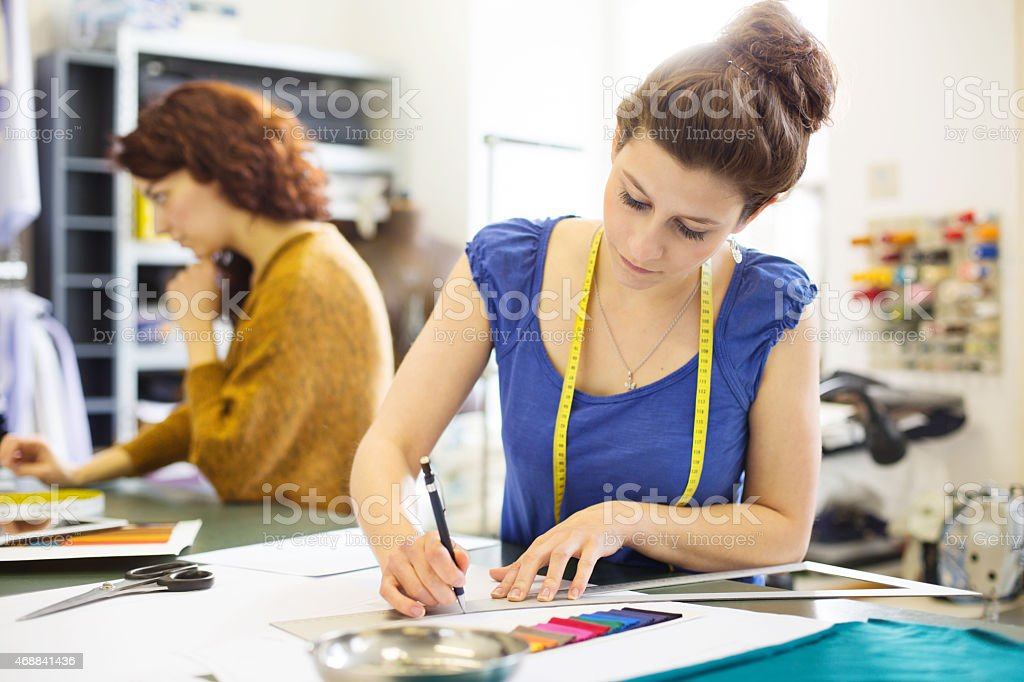 Fashion designer working on new dress design stock photo