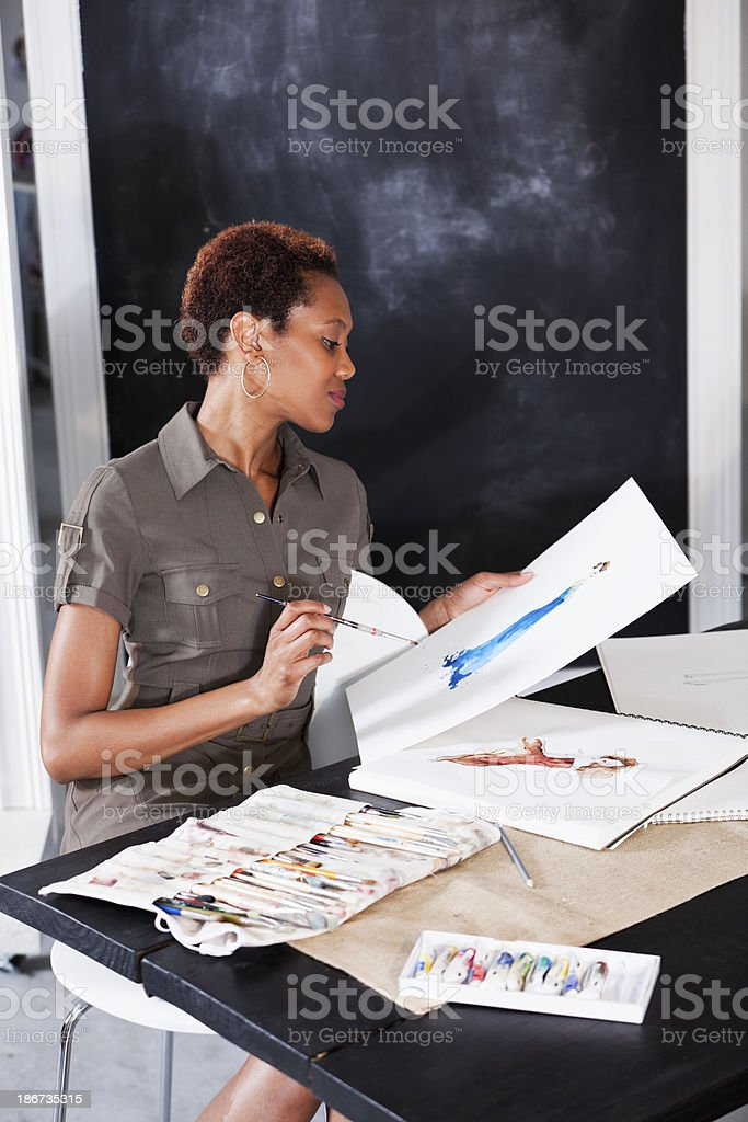 Fashion designer working on sketches stock photo