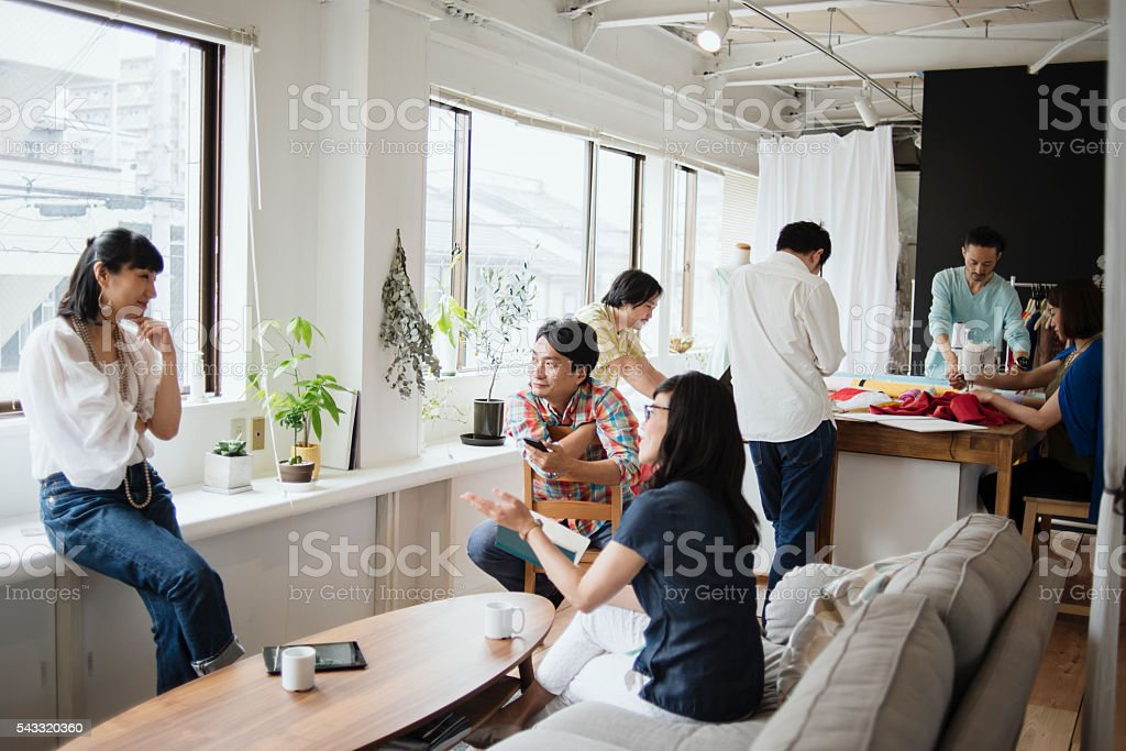 Fashion designers casual meeting in studio stock photo