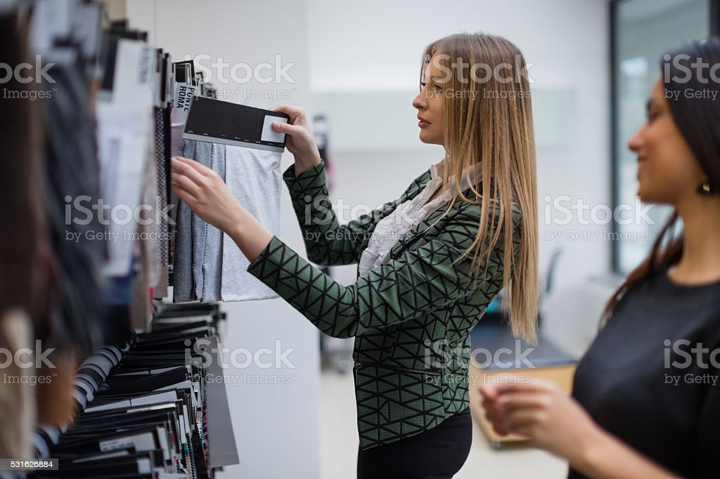 Fashion designers choosing swatches stock photo