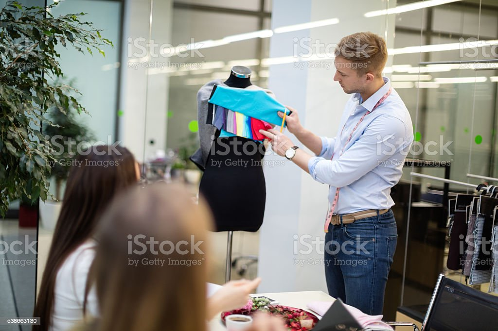 Fashion designers deciding on pattern stock photo