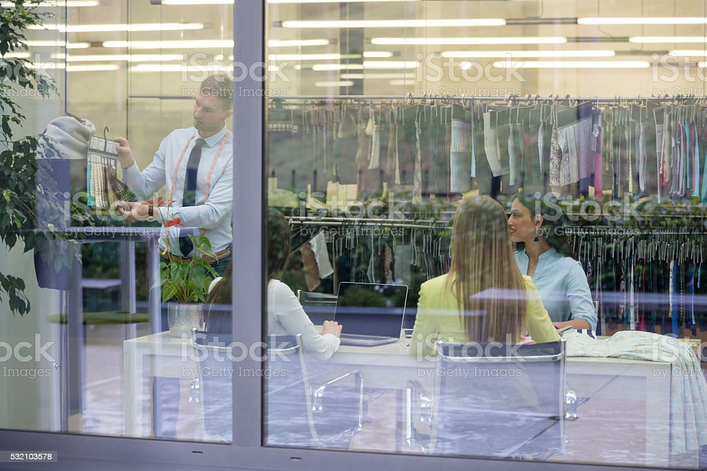 Fashion designers on a meeting stock photo