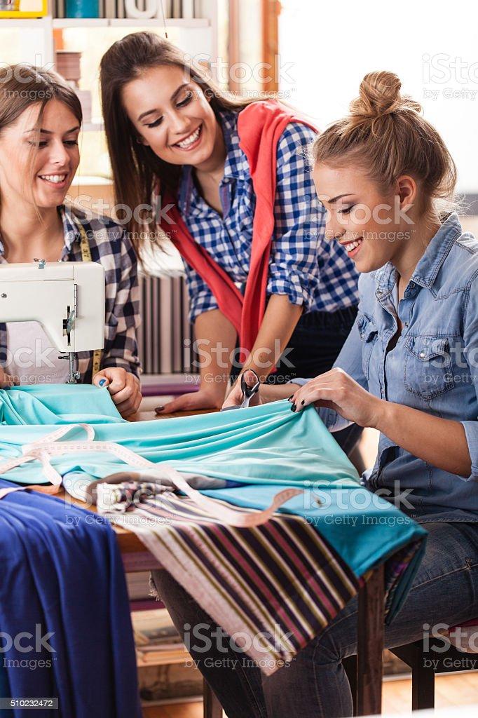 Fashion designers working in fashion studio stock photo